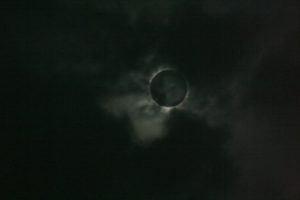 Total Solar Eclipse surfing between clouds